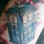 TARDIS Tattoo With Light Coming Out The Windows